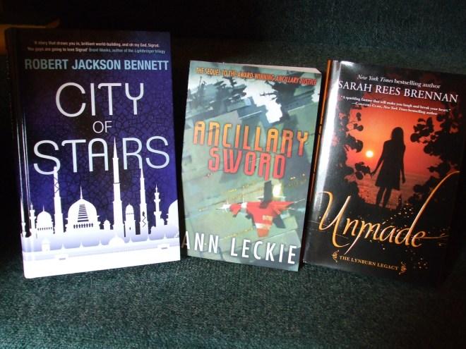 Books by Robert Jackson Bennett, Ann Leckie, and Sarah Rees Brennan.